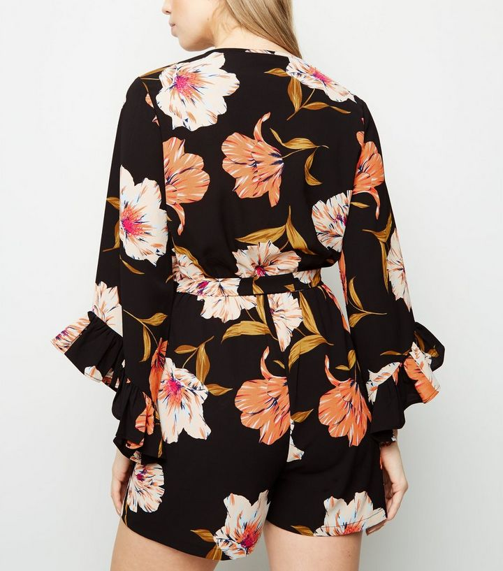 0ad8c12ceff9 ... Black Floral Ruffle Sleeve Wrap Playsuit. ×. ×. ×. Shop the look