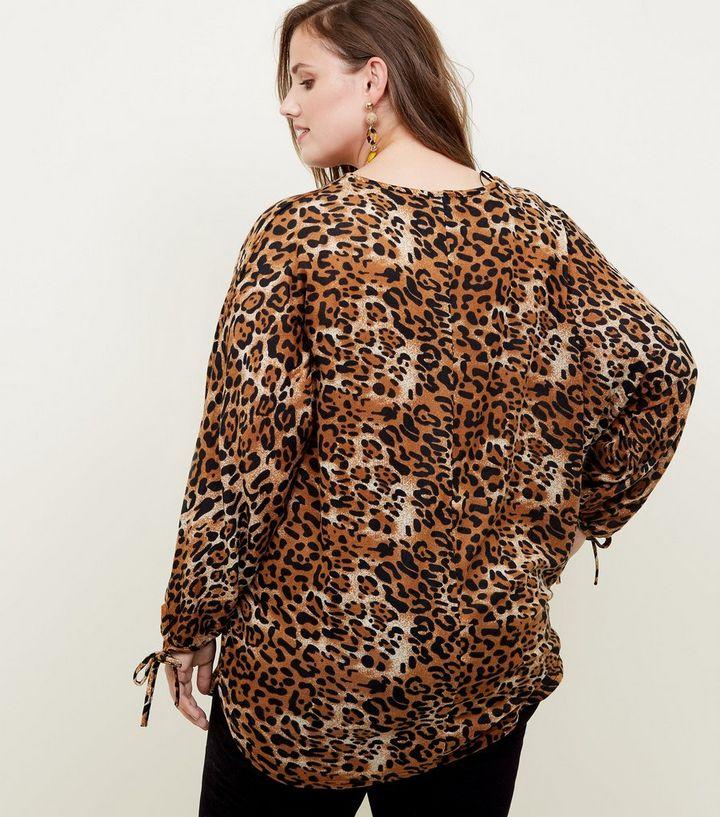 dfbce9482d26a ... Blue Vanilla Curves Brown Leopard Print Top. ×. ×. ×. Shop the look