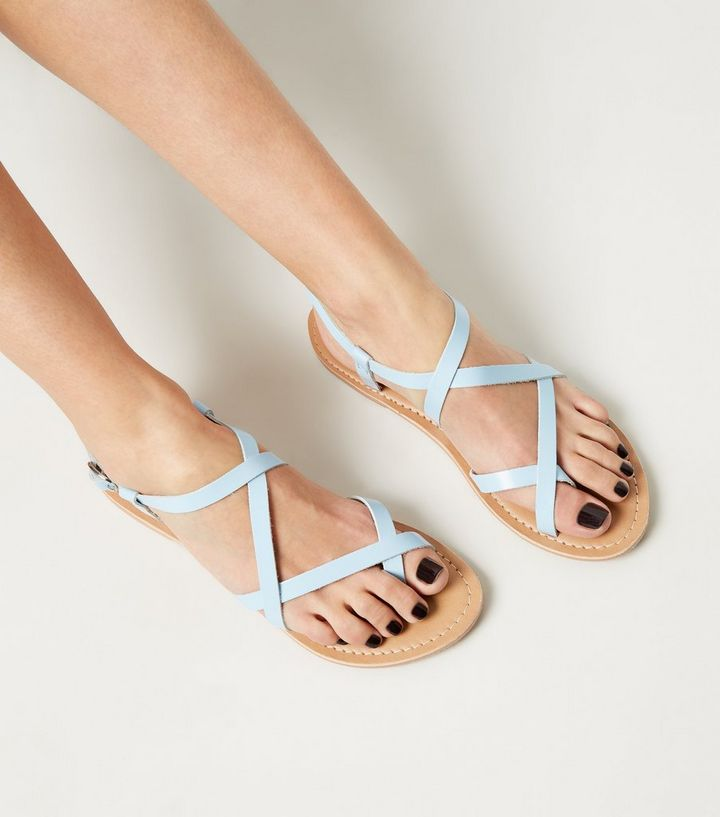 99bfd45d23f9 ... Pale Blue Leather Strappy Flat Sandals. ×. ×. ×. Shop the look