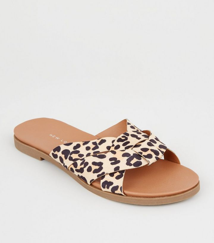 cb10661b79501 Wide Fit Stone Leopard Print Woven Footbed Sliders | New Look