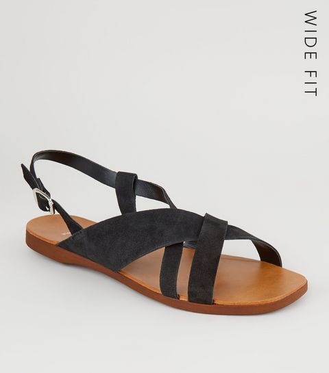 28b73949ef08 ... Wide Fit Black Suede Strappy Flat Sandals ...