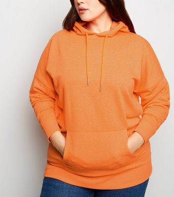 Curves – Oversize-Kapuzenpullover in Orange