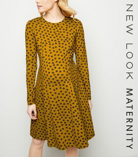 52f805379bb ... Maternity Orange Floral Soft Touch Skater Dress ...