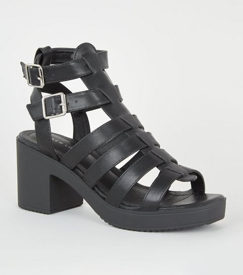 dbb11df87a08a ... Black Leather-Look Chunky Gladiator Sandals ...