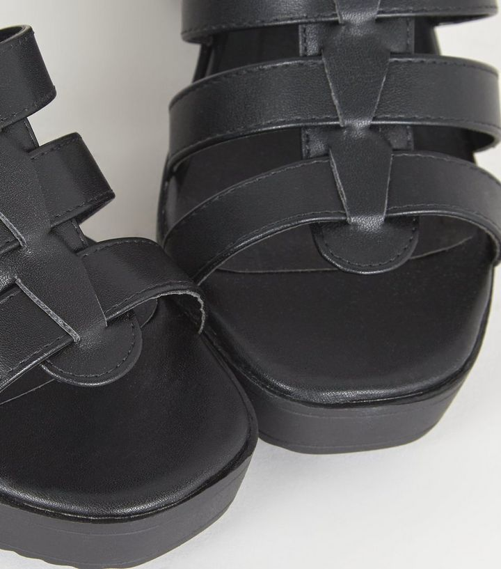 b8e68f135 ... Black Leather-Look Chunky Gladiator Sandals. ×. ×. ×. Shop the look