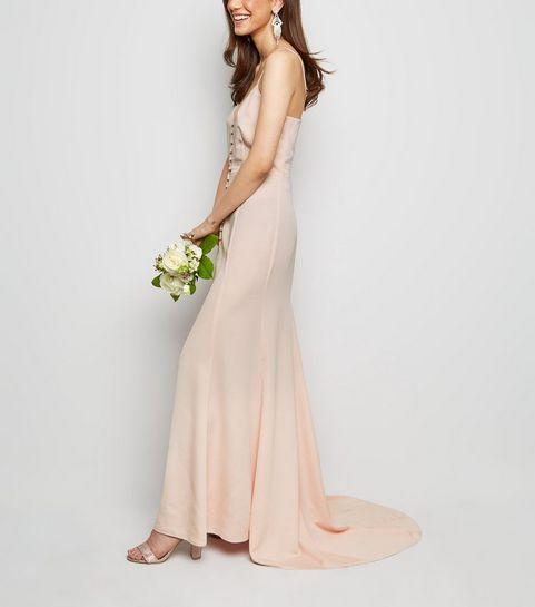 ec798643bd81 ... Robe longue rose pâle en satin boutonnée à l avant ...