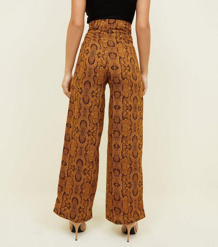 grand choix de valeur formidable livraison gratuite Innocence - Pantalon marron large à motif peau de serpent Ajouter à la  Wishlist Supprimer de la Wishlist