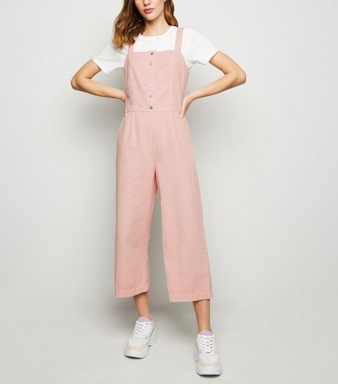 63193d436c2 ... Pink Popper Front Denim Jumpsuit ...