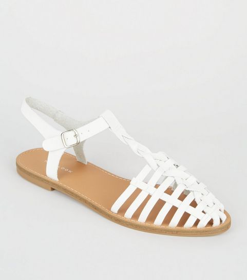 b05facd9373595 ... White Leather-Look Woven T-Bar Sandals ...