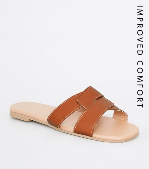 bff8a6a031a58 ... Tan Leather-Look Interlocked Strap Sliders ...