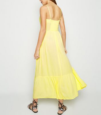 shop for Pale Yellow Crinkle Tiered Hem Midaxi Dress New Look at Shopo