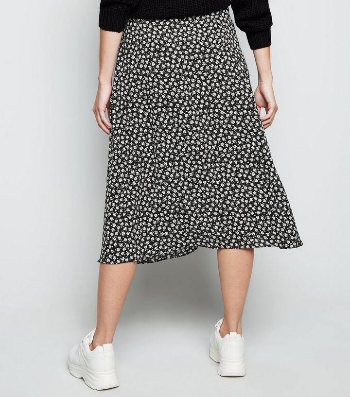 156f56d2fc2 ... Black Ditsy Floral Wrap Midi Skirt. ×. ×. ×. Shop the look