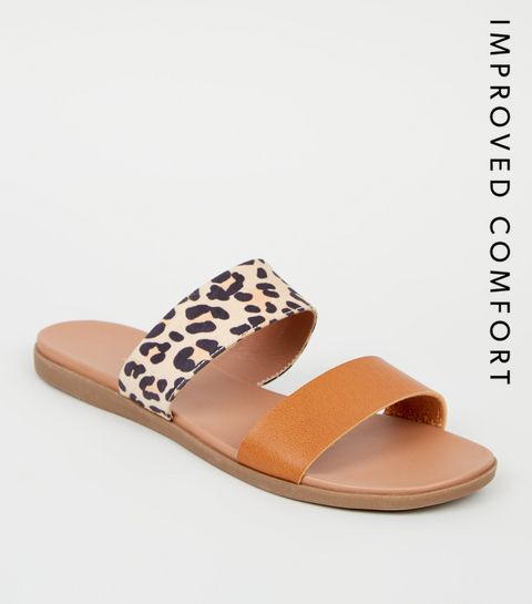 a538a97fdcfd ... Stone Leopard Print Strap Footbed Sliders ...