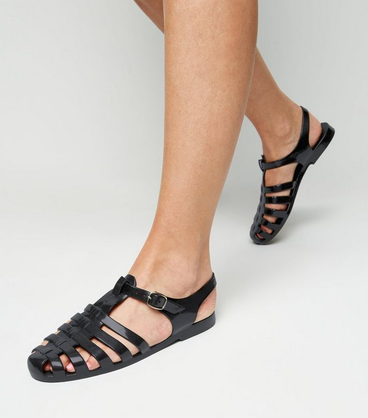 caa862599d9 Black T-Bar Caged Jelly Sandals Add to Saved Items Remove from Saved Items
