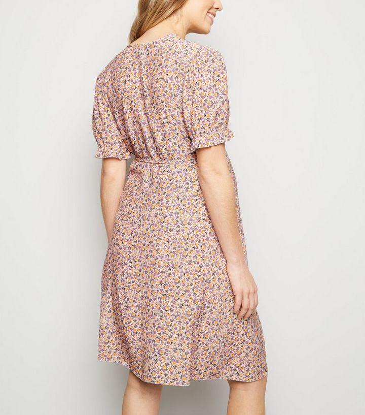 d6a5119fea63a ... Maternity Pink Floral Frill Hem Wrap Dress. ×. ×. ×. Shop the look