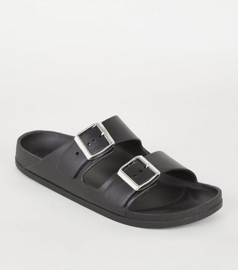 d4e31e196440 ... Black Leather-Look Buckle Strap Footbed Sliders ...