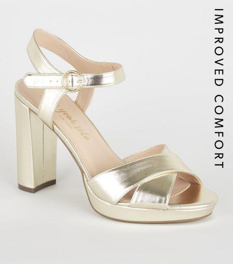 8639a153510 ... Gold Metallic Cross Strap Block Heels ...