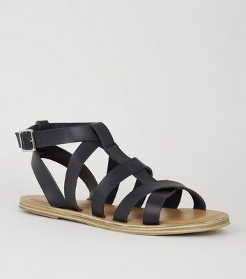 Girls – Schwarze Römersandalen in Leder-Optik