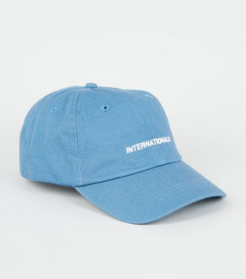 4897db7f638ad ... Pale Blue International Embroidered Slogan Cap ...