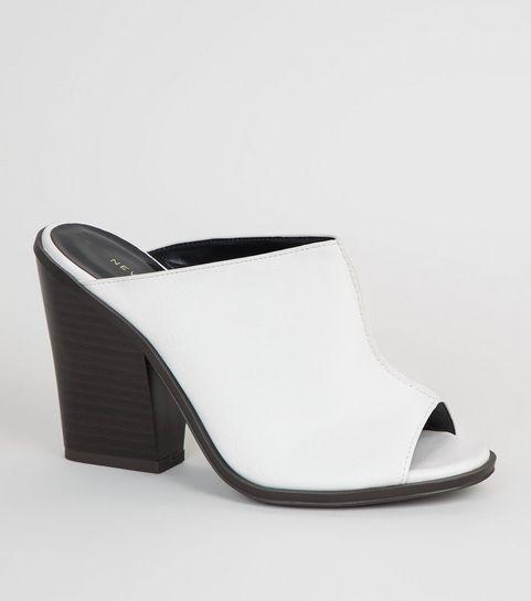 5028154d1af7 ... Mules blanches en similicuir à couture sur le devant ...