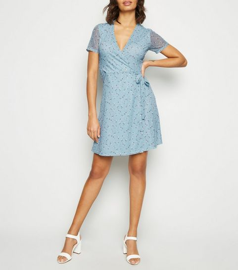 d61aa9b7412 ... Blue Floral Mesh Mini Wrap Dress ...