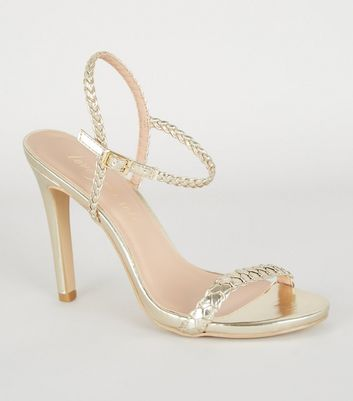 Goldfarbene High Heels mit Metallic-Flechtwerk