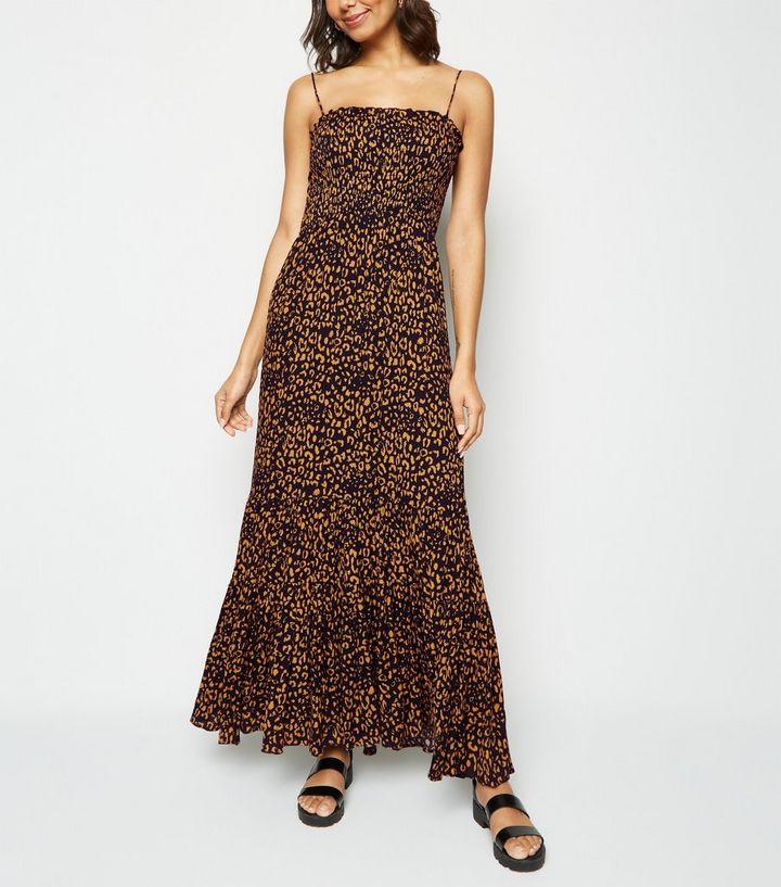28501f02f48 Navy Leopard Print Shirred Tier Maxi Dress