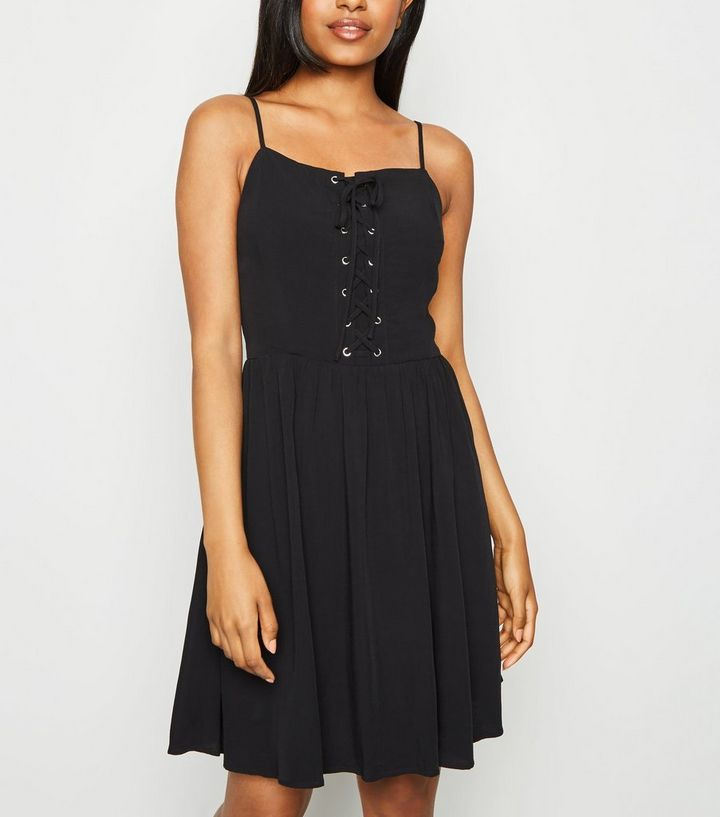 a3b9e9033e7de Petite Black Lace Up Skater Dress | New Look