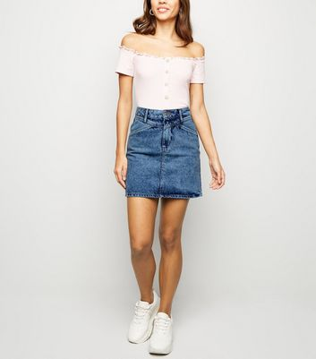 denim skirt and trainers