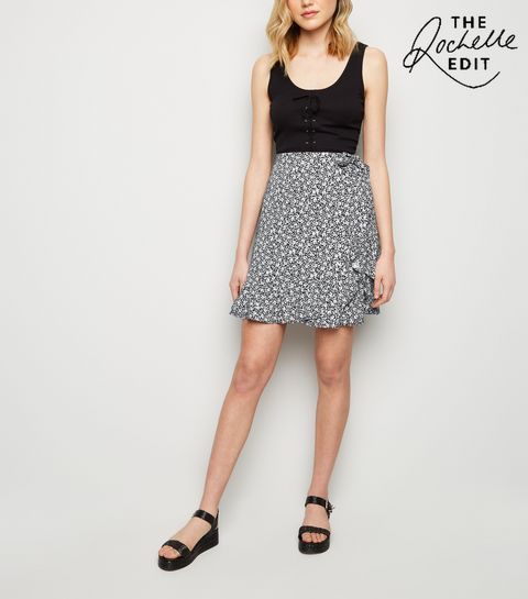 bcaacfd647aae ... Black Ditsy Floral Wrap Front Mini Skirt ...