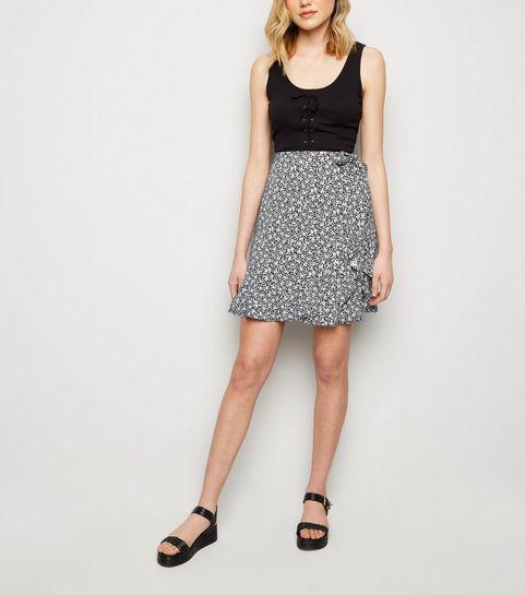 c6f81b8607 ... Black Ditsy Floral Wrap Front Mini Skirt ...
