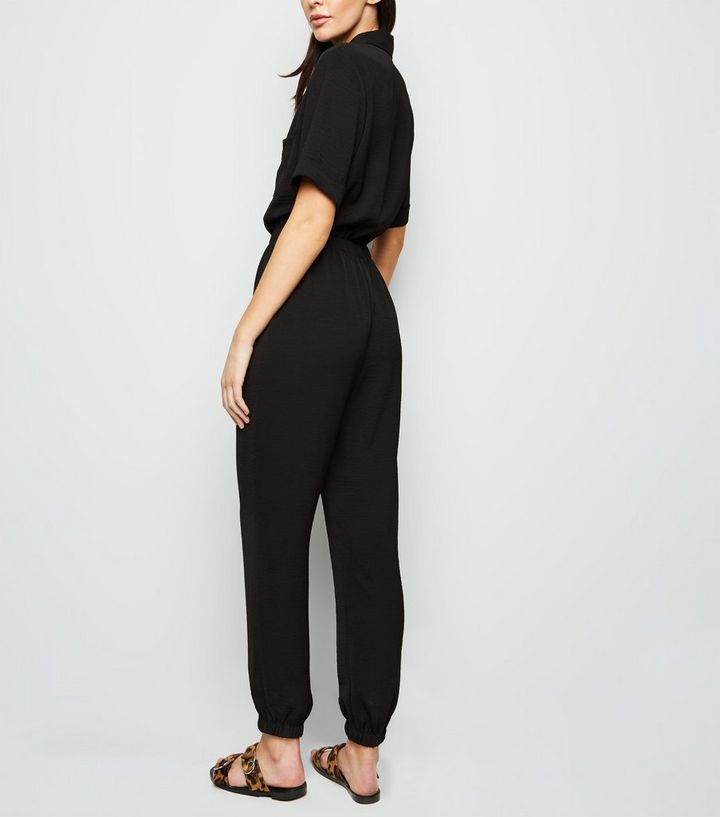 b162ddefa333 ... Black Herringbone Cuffed Utility Jumpsuit. ×. ×. ×. Shop the look