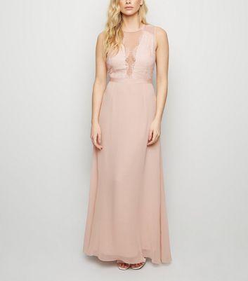 Robe longue rose en dentelle et mousseline