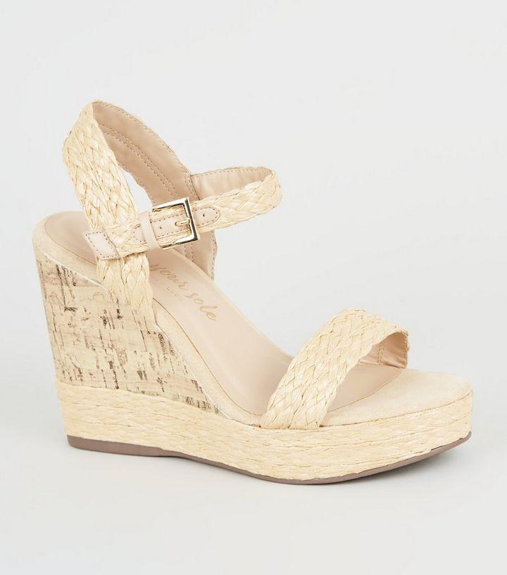 buy online 9254e 6e524 Schuhe mit Keilabsatz aus Kork und Flechtriemchen in gedecktem Weiß Für  später speichern Von gespeicherten Artikeln entfernen