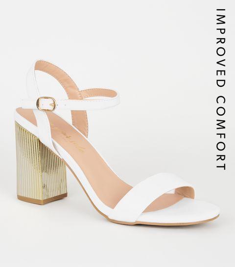 b4d3115a0cc6c8 ... Chaussures blanches en similicuir à talons blocs métallisés ...