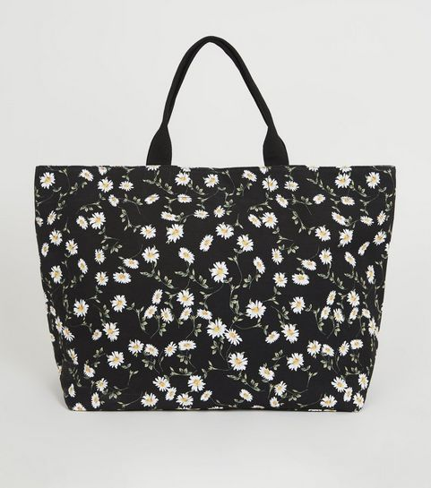 aa9733d2cf ... Grand sac noir en toile à imprimé pâquerettes ...