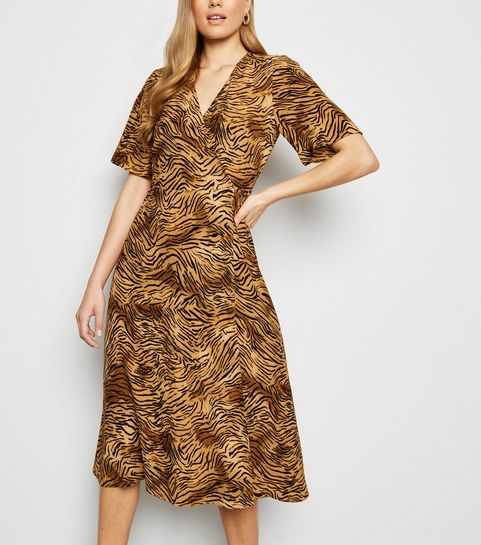 9267c3c9bd35 ... Brown Tiger Print Midi Wrap Dress ...