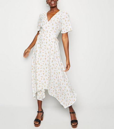 a46c19d02678 ... White Ditsy Floral Hanky Hem Wrap Midi Dress ...