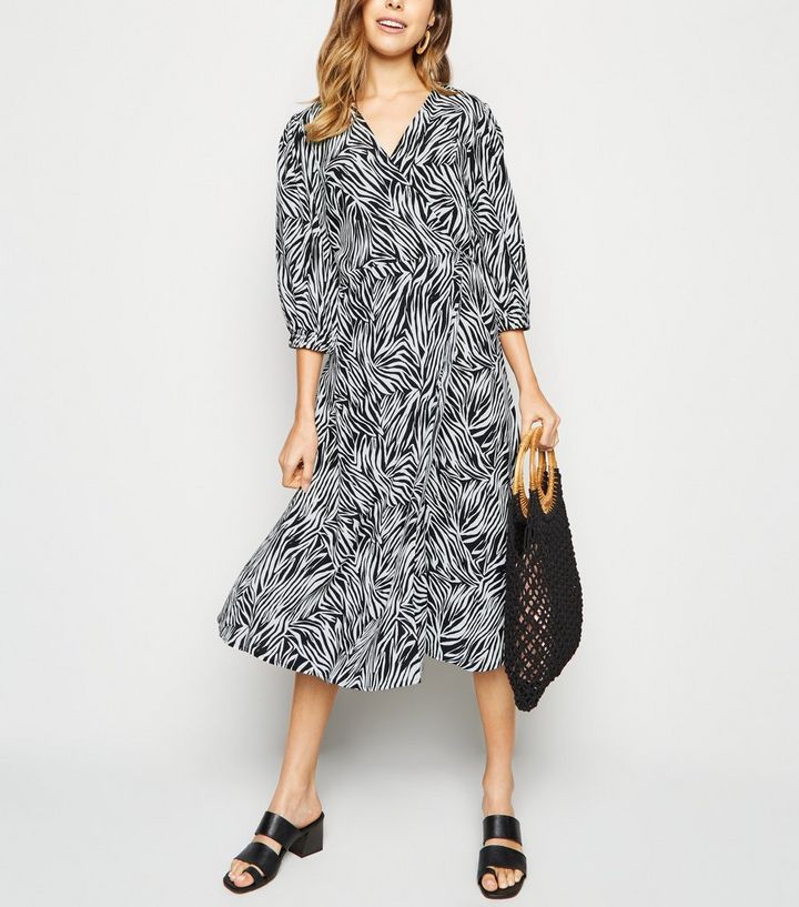 2449a08548e6 Black Zebra Print Puff Sleeve Midi Wrap Dress