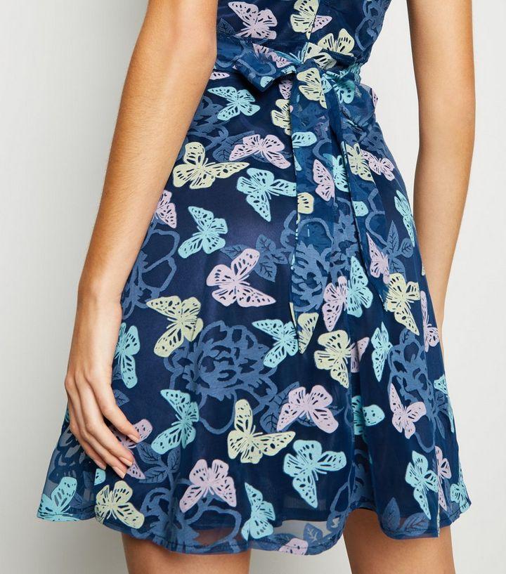 9d2d29f15b4 ... Mela Blue Butterfly Mesh Overlay Dress. ×. ×. ×. Shop the look