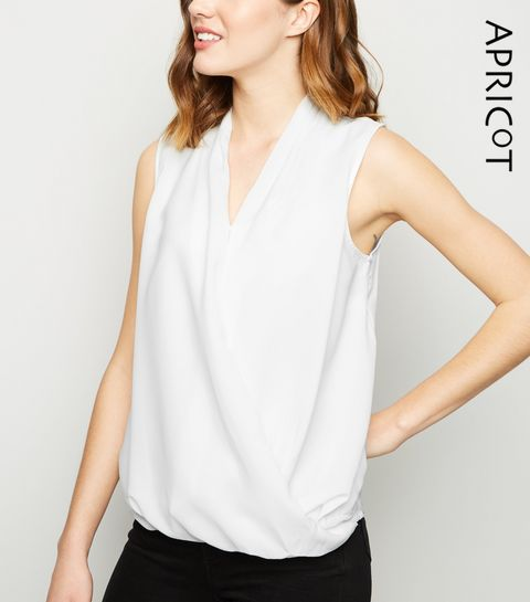 9b2203cf1a1670 ... Apricot White Crossover Wrap Top ...