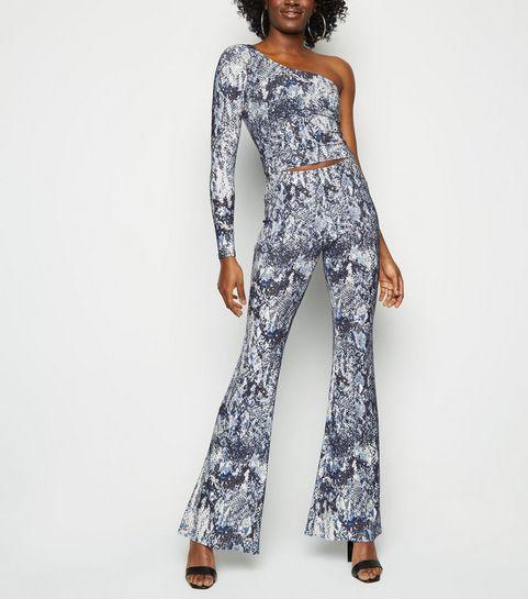 623cf4dc7 ... Off White Snake Print Glitter Flared Trousers ...