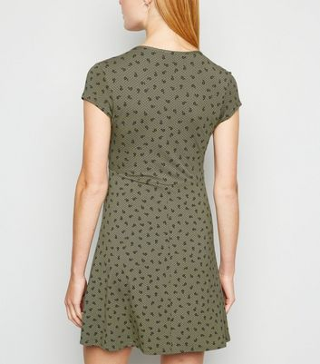 Click to view product details and reviews for Khaki Floral Spot Jersey Empire Skater Dress New Look.