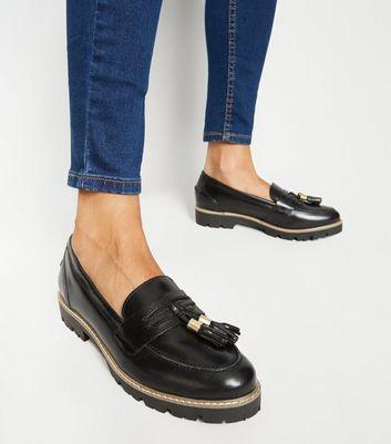 black leather tassel loafers