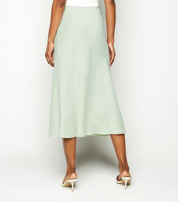 Click to view product details and reviews for Mint Green Satin Bias Cut Midi Skirt New Look.