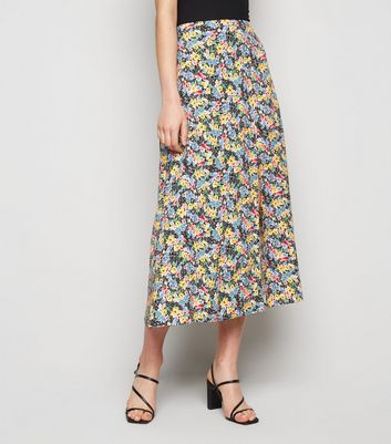 Click to view product details and reviews for Black Floral Side Split Midi Skirt New Look.