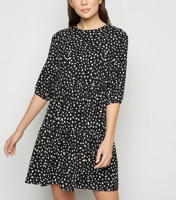 Click to view product details and reviews for Black Spot Print Tiered Mini Smock Dress New Look.