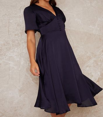 Click to view product details and reviews for Chi Chi London Navy Button Front Satin Midi Dress New Look.